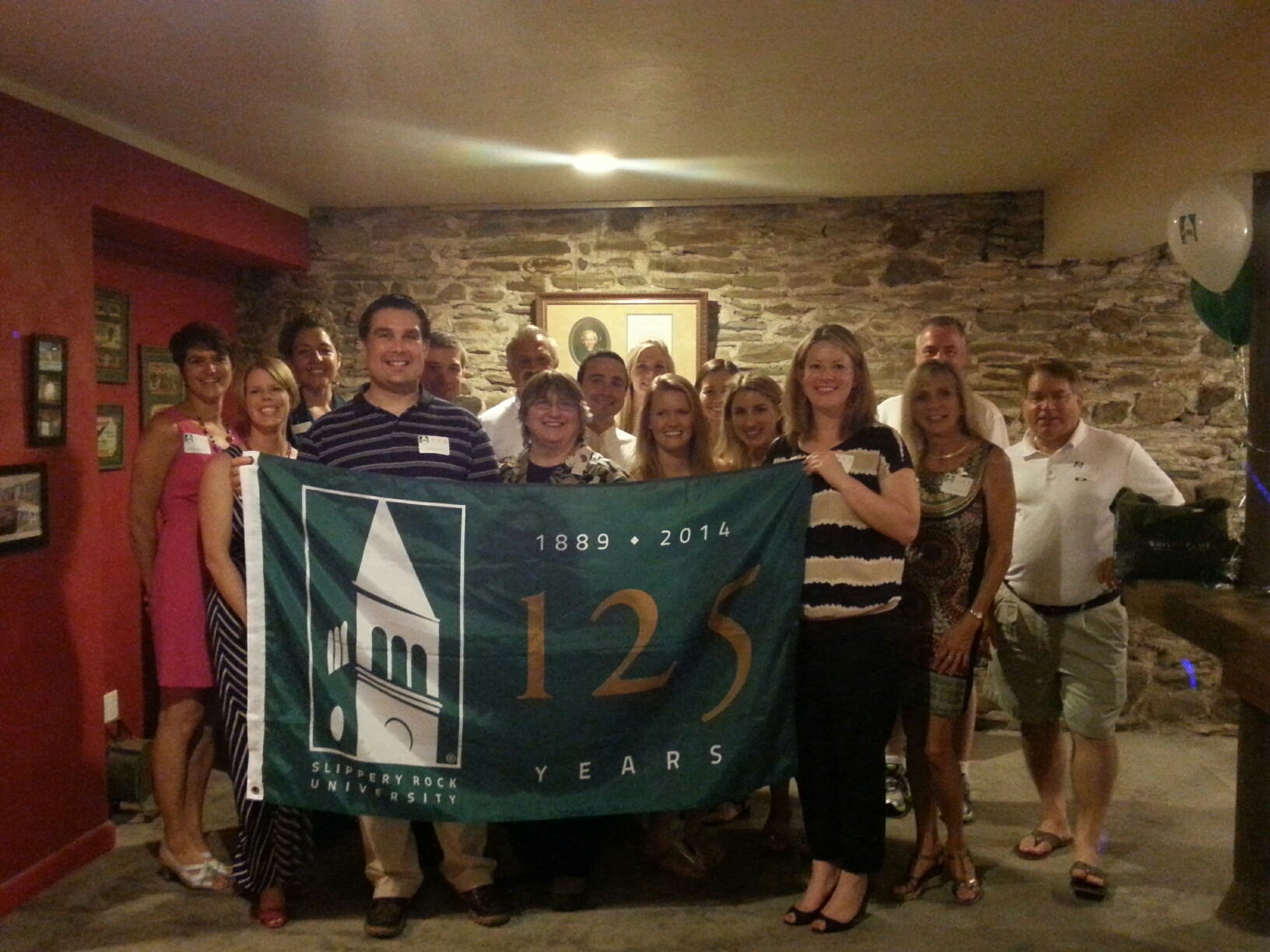 SRU Alumni Holding banner at Erie Event